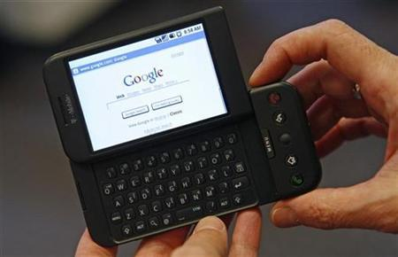 A woman holds a Google T-Mobile G1 mobile telephone at a T-Mobile store in New York City, October 22, 2008. REUTERS/Mike Segar
