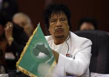 <p>Libyan leader Muammar Gaddafi attends the plenary session at the Africa-South America Summit in Margarita Island September 26, 2009. REUTERS/Carlos Garcia Rawlins</p>