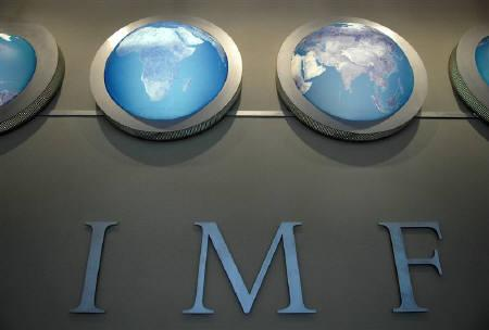 The IMF nameplate is displayed on a wall at the headquarters during the World Bank/International Monetary Fund Spring Meetings in Washington in this April 11, 2008 file photo.  REUTERS/Jonathan Ernst/Files