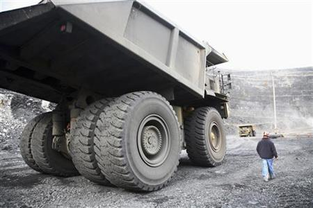 A truck removes rock and dirt from an open pit mine, March 11, 2008. REUTERS/Adam Tanner
