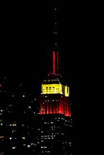The Empire State Building is seen lit red and yellow marking the 60th anniversary of Communist China in New York, September 30, 2009. REUTERS/Shannon Stapleton