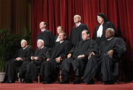U.S. Supreme Court Justices gather for an official picture at the Supreme Court in Washington September 29, 2009. REUTERS/Jim Young