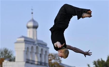 A man practises parcour near Sofia Cathedral in Veliky Novgorod some 520 km (323 miles) northwest of Moscow October 5, 2008. REUTERS/Mikhail Mordasov