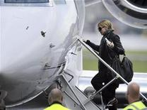 <p>Pop star Madonna boards the plane as she leaves Helsinki, August 7, 2009. REUTERS/LEHTIKUVA/Roni Rekomaa</p>