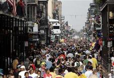 <p>Revelers make their way down Bourbon St. while celebrating Mardi Gras Day in New Orleans February 5, 2008. REUTERS/Sean Gardner</p>