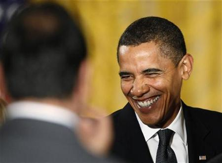 U.S. President Barack Obama smiles after making remarks on regulatory reform in the East Room at the White House in Washington October 9, 2009. REUTERS/Jim Young