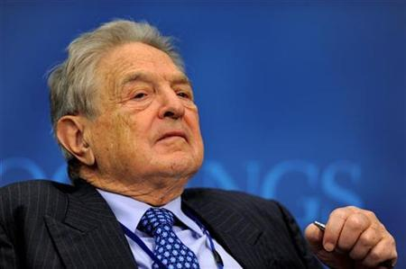 Investor George Soros listens to remarks as he takes part in a Brookings Institution discussion in Washington, April 24, 2009. REUTERS/Mike Theiler