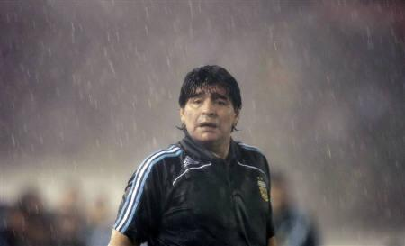 Argentina's head coach Diego Maradona stands in rain during their World Cup 2010 qualifying soccer match against Peru in Buenos Aires, October 10, 2009. REUTERS/Marcos Brindicci