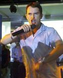 <p>Stephen Gately of the boy band Boyzone speaks to fans at a music store in Bombay in this August 2, 2000 file photo. REUTERS/Savita Kirloskar/Files</p>