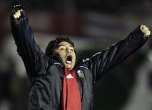 <p>Técnico da seleção argentina Diego Maradona comemora gol da equipe na vitória por 1 x 0 sobre o Uruguai em Montevidéu REUTERS/Andres Stapff</p>