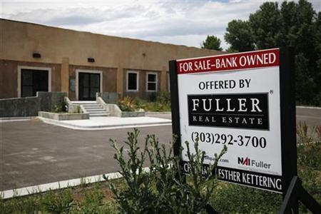 A bank-owned property for sale sign outside an unfinished and vacant building in Arvada, Colorado June 23, 2009. Picture taken June 23, 2009. REUTERS/Rick Wilking