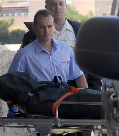 Workers transport the body of Boyzone's singer Stephen Gately at the hospital morgue in Palma de Mallorca on the Spanish island of Mallorca October 13, 2009.  REUTERS/Stringer