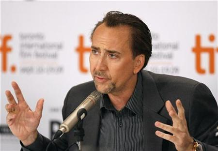 Actor Nicolas Cage gestures during the news conference for the film ''Bad Lieutenant: Port Of Call New Orleans'' at the 34th Toronto International Film Festival in Toronto September 15, 2009. REUTERS/Mike Cassese