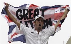 <p>Campeão da Fórmula 1 Jenson Button passou a noite em claro em São Paulo. REUTERS/Bruno Domingos</p>