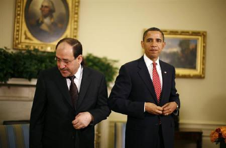 U.S. President Barack Obama and Iraqi Prime Minister Nuri al-Maliki rise after speaking to reporters in the Oval Office of the White House in Washington October 20, 2009. Obama urged Iraq on Tuesday to complete an election law so that a January poll is not delayed. REUTERS/Kevin Lamarque