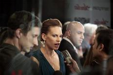 "<p>Actress Hilary Swank is interviewed as she arrives for the premiere of the film ""Amelia"" in New York, October 20, 2009. REUTERS/Lucas Jackson</p>"