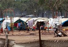<p>Children play in a playground at the Settikulam camp for internally displaced people (IDP) in northern Sri Lanka August 15, 2009. REUTERS/Stringer</p>