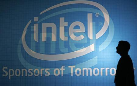 A man walks past an Intel wall at the 2009 Computex trade show in Taipei in this June 3, 2009 file photo. REUTERS/Pichi Chuang/Files
