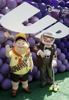 Characters Russell (L) and Carl Fredricksen pose at the premiere of the Disney-Pixar animated film ''Up'' in Hollywood, California May 16, 2009. REUTERS/Fred Prouser