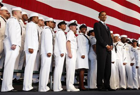 President Obama listens to opening remarks before speaking to servicemen and women at Naval Air Station Jacksonville in Florida, October 26, 2009. REUTERS/Jim Young