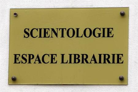 The sign of the Scientology library is seen on the headquarters of the Church of Scientology in Paris May 19, 2009. A Paris court on Tuesday fined the French branch of the Church of Scientology a total of 600,000 euros ($902,200) after finding it guilty of fraud but allowed the group to continue operating in France. REUTERS/Charles Platiau/fILES