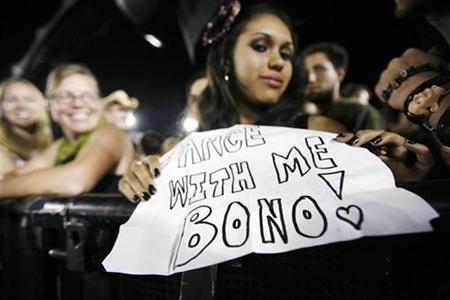 April Dalaman holds a sign as she waits before a concert by rock band U2 at Rose Bowl in Pasadena, California October 25, 2009. REUTERS/Mario Anzuoni