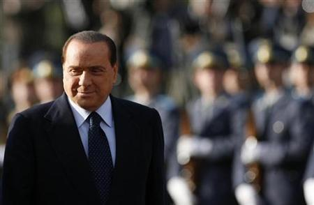 Italy's Prime Minister Silvio Berlusconi reviews the Bulgarian army honour guard during an official ceremony in Sofia, October 15, 2009. REUTERS/Stoyan Nenov