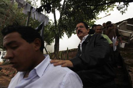 Honduras' ousted President Manuel Zelaya walks after an interview with a local radio station inside the Brazilian embassy in Tegucigalpa, October 31, 2009.  REUTERS/Edgard Garrido