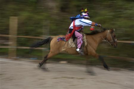 A rider takes part in a traditional horse race on All Saints Day in Todos Santos, Guatemala November 1, 2009. REUTERS/Daniel LeClair