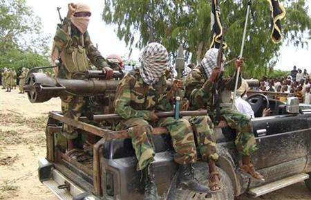 Members of the hardline Al Shabaab Islamist rebel group sit on a pick-up during a demonstration in Mogadishu, October 30, 2009. REUTERS/Omar Faruk