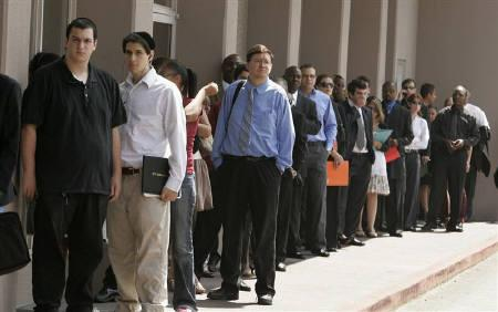 A line of job seekers stretches out of a hotel doorway as they wait to enter a Monster.com job fair in Los Angeles, California in this July 23, 2008 file photo. REUTERS/Fred Prouser/Files