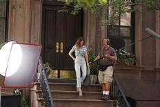 "<p>Actress Sarah Jessica Parker prepares to act in a scene during the filming of the upcoming movie ""Sex and the City 2"" in New York September 4, 2009. REUTERS/Lucas Jackson</p>"
