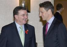 <p>U.S. Treasury Secretary Timothy Geithner (L) talks to Canada's Finance Minister Jim Flaherty at the G20 Finance Ministers meeting at a hotel in St. Andrews, Scotland November 7, 2009. REUTERS/Andrew Winning</p>
