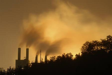 Smoke rises out of a cement plant in Baokang, Hubei province September 12, 2009. Picture taken September 12, 2009. REUTERS/Stringer/Files