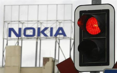 A light shows red in front of the factory of Nokia in Bochum January 15, 2008. REUTERS/Ina Fassbender