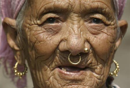 A Bhutanese refugee woman is seen inside the Timai refugee camp in the east of Nepal March 19, 2008. REUTERS/Rupak De Chowdhuri/Files