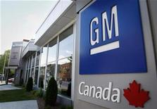 <p>A General Motors logo is seen at a dealership in Montreal in this May 31, 2009 file photo. GM is planning to invest almost $100 million at the CAMI Automotive plant in Ingersoll, Ontario, the Globe and Mail said, citing sources familiar with GM's plans. REUTERS/Christinne Muschi</p>