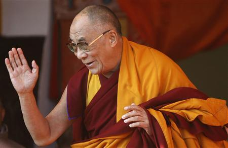 Tibetan spiritual leader, the Dalai Lama, gestures as he leaves after delivering Buddhist teachings at Tawang, in the northeastern Indian state of Arunchal Pradesh November 9, 2009. REUTERS/Adnan Abidi