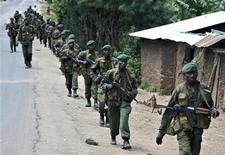 <p>Congolese soldiers patrol the town of Rutshuru in eastern Congo, January 28, 2009. REUTERS/Alissa Everett</p>