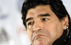"""<p>O técnico da Argentina, Diego Maradona, concede entrevista coletiva em Madri, na Espanha, nesta quinta-feira. Ele está satisfeito com o desempenho de Lionel Messi e deseja que o atacante do Barcelona se comporte como se fosse o """"dono"""" do time. REUTERS/Juan Medina</p>"""