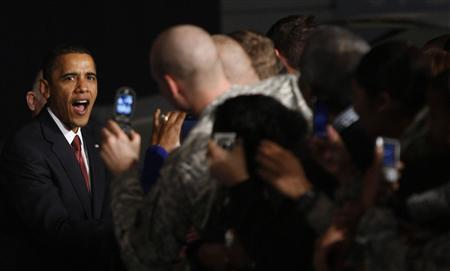 U.S. President Barack Obama greets U.S. military service personnel and their family members at Elmendorf Air Force Base in Alaska November 12, 2009. REUTERS/Jason Reed