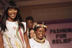 "<p>British supermodel Naomi Campbell smiles at the end of the catwalk with fellow models at her fifth ""Fashion for Relief"" charity fundraiser in Tanzania's capital Dar es Salaam, November 12, 2009. REUTERS/Katrina Manson</p>"