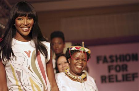 "British supermodel Naomi Campbell smiles at the end of the catwalk with fellow models at her fifth ""Fashion for Relief"" charity fundraiser in Tanzania's capital Dar es Salaam, November 12, 2009. REUTERS/Katrina Manson"