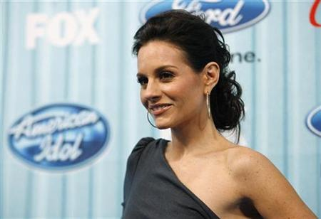 American Idol judge Kara DioGuardi poses at the party for the 12 finalists of the television show ''American Idol'' in Los Angeles March 5, 2009. REUTERS/Mario Anzuoni
