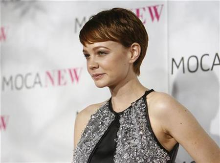 Actress Carey Mulligan poses at the MOCA (Museum of Contemporary Art) New 30th anniversary gala in Los Angeles November 14, 2009. REUTERS/Mario Anzuoni