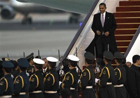 President Barack Obama steps off Air Force One upon his arrival in Beijing, November 16, 2009. REUTERS/Jason Lee
