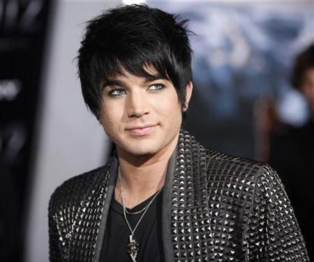Former American Idol contestant Adam Lambert, who performed the song ''Time For Miracles'' on the soundtrack for the film ''2012'', arrives for its premiere at Regal Cinemas LA Live in downtown Los Angeles November 3, 2009. REUTERS/Danny Moloshok