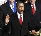 <p>The 44th President of the United States, Barack Obama, takes the oath given by Supreme Chief Justice John Roberts, Jr. (not in photo) during the inauguration ceremony in Washington, January 20, 2009. REUTERS/Jim Bourg</p>