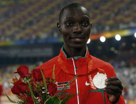 Asbel Kipruto Kiprop of Kenya poses during the medal's ceremony of the athletics competition during the Beijing 2008 Olympic Games in this August 2008 file photo. Asbel Kipruto Kiprop says his pleasure and pride at being awarded the gold medal retrospectively has been tainted by the circumstances of his victory.     REUTERS/Carlos Barria/Files