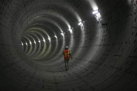 A Delhi Metro Rail Corporation (DMRC) employee walks inside a tunnel on the phase II stretch between Jangpura and Lajpat Nagar stations in New Delhi, October 12, 2009. REUTERS/Parth Sanyal